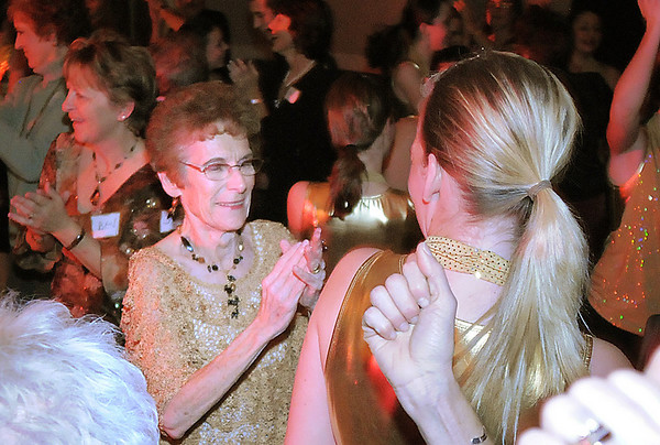 Jane Spain, center, founder of Dance Arts Studio, dances with friends, students and alumni during Friday's gala celebrating 50 years of dance with Dance Arts Studio at the Chateau at Fox Meadows. <br /> November 12, 2010<br /> staff photo/David R. Jennings