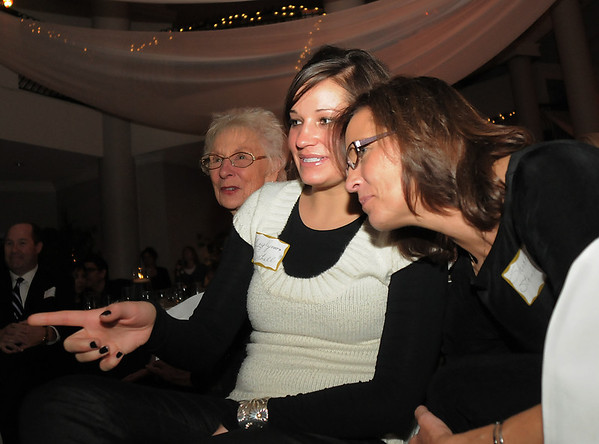 Sherri Vasko Steinbeck, right, an original student of Jane Spain in 1961, and her daughter Caylynn Schell, also an alumni, watch students perform during Friday's gala celebrating 50 years of dance with Dance Arts Studio at the Chateau at Fox Meadows. <br /> November 12, 2010<br /> staff photo/David R. Jennings