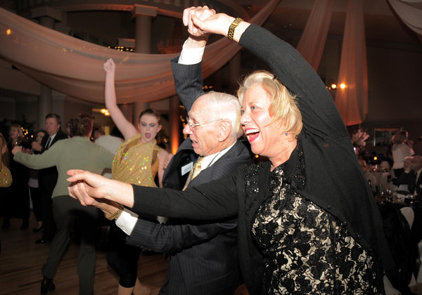 Heidi Thomas, right, owner of Dance Arts Studio, dances with Richard Morrow, the brother of the founder of the studio, Jane Spain, during Friday's gala celebrating 50 years of dance with Dance Arts Studio at the Chateau at Fox Meadows. <br /> November 12, 2010<br /> staff photo/David R. Jennings