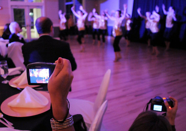 Parents take video of student dancers performing during Friday's gala celebrating 50 years of dance with Dance Arts Studio at the Chateau at Fox Meadows. <br /> November 12, 2010<br /> staff photo/David R. Jennings