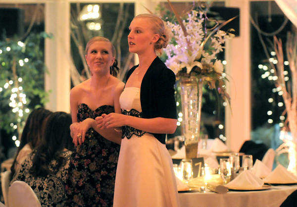 Mindy Haney, left, and Stephanie McGill, alumni of Dance Arts Studio, wait for the celebration to begin at  Friday's gala celebrating 50 years of dance with Dance Arts Studio at the Chateau at Fox Meadows. <br /> November 12, 2010<br /> staff photo/David R. Jennings
