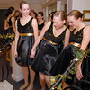 Fusion dancers Gloria Fuhrman, left, Katie Bernatis and Gracie Lee watch for the signal to begin their performance during Friday's gala celebrating 50 years of dance with Dance Arts Studio at the Chateau at Fox Meadows. <br /> November 12, 2010<br /> staff photo/David R. Jennings