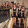 The dance troupe Fusion marches down the winding stair case to begin the dance performances at the gala celebrating 50 years of dance with Dance Arts Studio on Friday at the Chateau at Fox Meadows. <br /> November 12, 2010<br /> staff photo/David R. Jennings