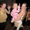Gloria Fuhrman, 18, left, dances with Katie Bernatis, 17, holding Tanith Britton, 4, during Friday's gala celebrating 50 years of dance with Dance Arts Studio at the Chateau at Fox Meadows. <br /> November 12, 2010<br /> staff photo/David R. Jennings