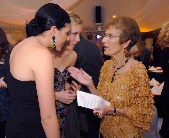 Jane Spain, right, talks with Megan Duran, left, and Mindy Haney, alumni of Dance Arts Studio, during Friday's gala celebrating 50 years of dance with Dance Arts Studio at the Chateau at Fox Meadows. <br /> November 12, 2010<br /> staff photo/David R. Jennings