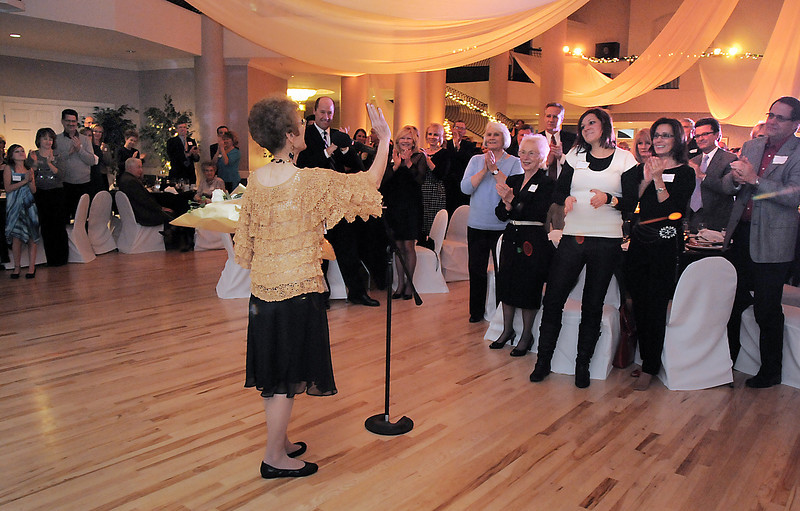 Founder of Morrow School of Dance now Dance Arts Studio, Jane Spain receives a standing ovation after giving her speech during Friday's gala celebrating 50 years of dance with Dance Arts Studio at the Chateau at Fox Meadows. <br /> November 12, 2010<br /> staff photo/David R. Jennings