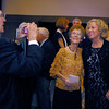 Richard Morrow, left, takes a picture of his sister, Jane Spain, center, and Heidi Thomas during the gala celebrating 50 years of dance with Dance Arts Studio on Friday at the Chateau at Fox Meadows. <br /> November 12, 2010<br /> staff photo/David R. Jennings
