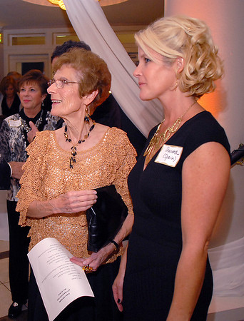 Jane Spain, left, and her daughter Shauna Spain Ladriola greet people attending Friday's gala celebrating 50 years of dance with Dance Arts Studio in Broomfield at the Chateau at Fox Meadows. <br /> November 12, 2010<br /> staff photo/David R. Jennings