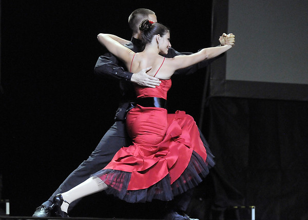 Amy McKellar and Evin Larsen (Fred Astaire Studio) perform a tango/salsa dance at Dancing With The Broomfield Stars at the 1stBank Center on Wednesday.<br /> September 22, 2011<br /> staff photo/ David R. Jennings