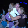 John Long gets hugs form his wife Jill and daughter Audrey, 4, after he and Carlee Taga won the Dancing With The Broomfield Stars at the 1stBank Center on Wednesday.<br /> September 22, 2011<br /> staff photo/ David R. Jennings