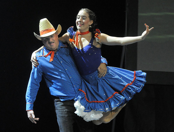 Randy Ahrens and Sophie Payannet (Danse Etoile Ballet) perform country/ballet dance at Dancing With The Broomfield Stars at the 1stBank Center on Wednesday.<br /> September 22, 2011<br /> staff photo/ David R. Jennings