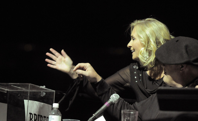 Linda Deland puts money in a bribe box for the judges before performing at Dancing With The Broomfield Stars at the 1stBank Center on Wednesday.<br /> September 22, 2011<br /> staff photo/ David R. Jennings