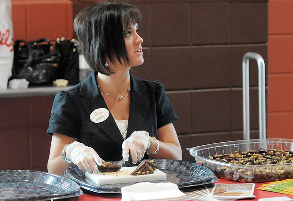 Stacy Swanson prepares food at the Chick-fil-a booth at Dancing With The Broomfield Stars at the 1stBank Center on Wednesday.<br /> September 22, 2011<br /> staff photo/ David R. Jennings