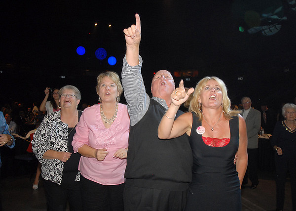 Fans cheer during the Phil Long Band performance at Dancing With The Broomfield Stars at the 1stBank Center on Wednesday.<br /> September 22, 2011<br /> staff photo/ David R. Jennings