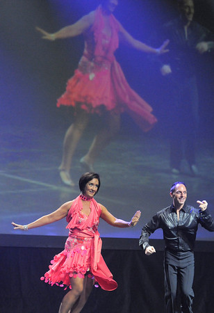 Jenifer Madson and Morris Vaccarella III (Arthur Murray dance studio) perform a mambo cha-cha dance at Dancing With The Broomfield Stars at the 1stBank Center on Wednesday.<br /> September 22, 2011<br /> staff photo/ David R. Jennings
