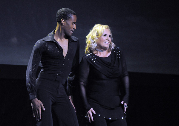 Linda Deland and Marcus Woods (Fred Astaire Dance Studio) perform a rumba/east coast swing at Dancing With The Broomfield Stars at the 1stBank Center on Wednesday.<br /> September 22, 2011<br /> staff photo/ David R. Jennings