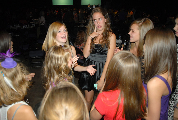 Rachel Kois, center, leads fellow Taps 'N Toes students in a dance while waiting for results at Dancing With The Broomfield Stars at the 1stBank Center on Wednesday.<br /> September 22, 2011<br /> staff photo/ David R. Jennings