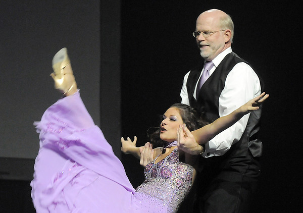 Ed Black and Courtney Duran (Fred Astaire Studio) perform the foxtrot at Dancing With The Broomfield Stars at the 1stBank Center on Wednesday.<br /> September 22, 2011<br /> staff photo/ David R. Jennings