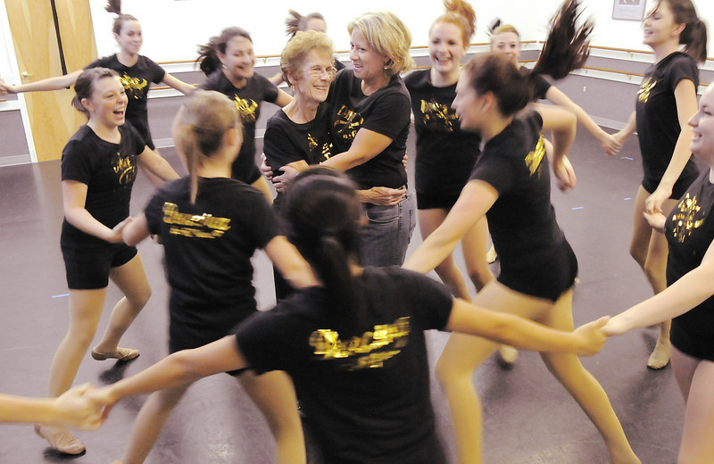 Dance Arts Studio founder Jane Spain and Heidi Thomas, current owner and a former student of Spain, are surrounded by the advanced class as they dance at the studio on Thursday.<br /> <br /> October 28, 2010<br /> staff photo/David R. Jennings