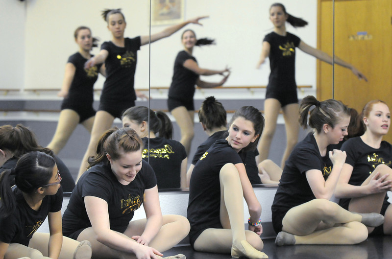 Dance Arts Studio adanced students warm up before rehearsing  on Thursday for the 50th anniversary celebration of  the studio founded by Jane Spain.<br /> <br /> October 28, 2010<br /> staff photo/David R. Jennings