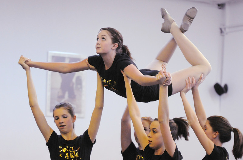 Jaden Ahrens is lifted by fellow daners at Dance Arts Studio as they rehearse for the 50th anniversary celebration of the studio  on Thursday.<br /> <br /> October 28, 2010<br /> staff photo/David R. Jennings