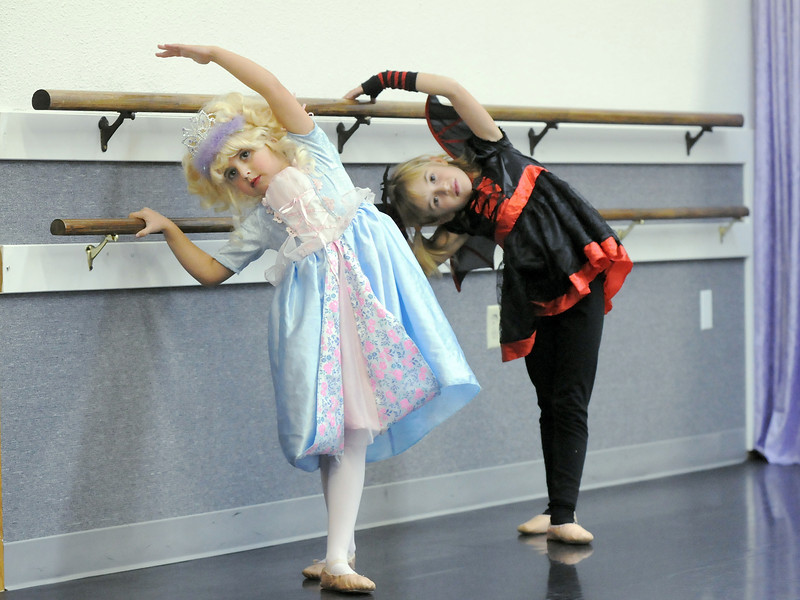 Phylissa Gilman, 6, left, and Emma Knight, 6, dressed in their Halloween costumes for class at the Dance Arts Studio on Thursday. Dance Arts founded by Jane Spain is celebrating it's 50th anniversary.<br /> <br /> October 28, 2010<br /> staff photo/David R. Jennings