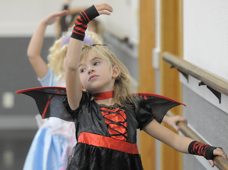 Emma Knight, 6, dressed in her Halloween costume for class at the Dance Arts Studio on Thursday. Dance Arts founded by Jane Spain is celebrating it's 50th anniversary.<br /> <br /> October 28, 2010<br /> staff photo/David R. Jennings