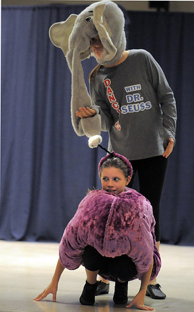 "Children's Dance Theater cast members Celeste Williams, 12, as the clover with Nicole Hicks, 13, as Horton, dance to the Dr. Seuss book, ""Horton Hears A Who"" during Wednesday's performance of Dancing With Dr. Seuss at Kohl Elementary School.<br /> September 14, 2011<br /> staff photo/ David R. Jennings"
