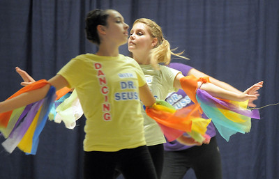 "Emiy Westbrook, 14, center, dances with cast members to the book ""My Many Colored Day"" during Wednesday's Children's Dance Theater performance of Dancing With Dr. Seuss at Kohl Elementary School. September 14, 2011 staff photo/ David R. Jennings"