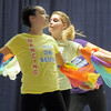 "Emiy Westbrook, 14, center, dances with cast members to the book ""My Many Colored Day"" during Wednesday's Children's Dance Theater performance of Dancing With Dr. Seuss at Kohl Elementary School.<br /> September 14, 2011<br /> staff photo/ David R. Jennings"