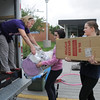 Heidi Thomas, left, takes props from cast member after Wednesday's Children's Dance Theater performance of Dancing With Dr. Seuss at Kohl Elementary School. Cast members not only dance but put up and take down the set.<br /> September 14, 2011<br /> staff photo/ David R. Jennings