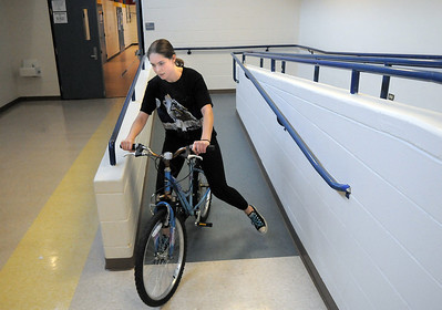 Elise Timme, 15, rides a bicycle prop to the van after Wednesday's Children's Dance Theater performance of Dancing With Dr. Seuss at Kohl Elementary School. Cast members not only dance but put up and take down the set. September 14, 2011 staff photo/ David R. Jennings