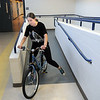 Elise Timme, 15, rides a bicycle prop to the van after Wednesday's Children's Dance Theater performance of Dancing With Dr. Seuss at Kohl Elementary School. Cast members not only dance but put up and take down the set.<br /> September 14, 2011<br /> staff photo/ David R. Jennings