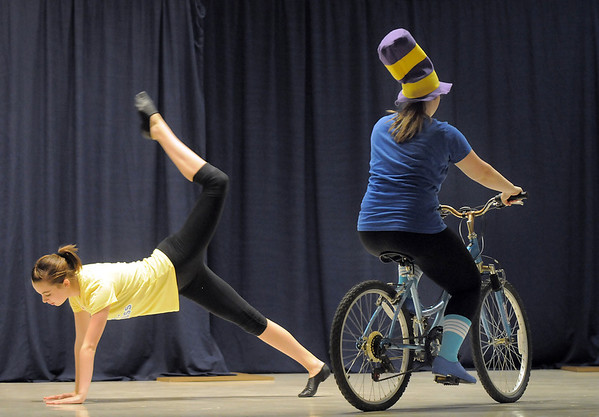 "Gabby Green, 15, and Allie Borman, 17, dance to the book ""Marvin K. Money Will You Please Go Now"" during Wednesday's Children's Dance Theater performance of Dancing With Dr. Seuss at Kohl Elementary School.<br /> September 14, 2011<br /> staff photo/ David R. Jennings"