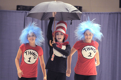 Tiana Threlkel, 17, center, as the Cat in the Hat, dances with Grace Peketz, 14, left, as Thing 1, and Elise Timme, 15, as Thing 2, during Wednesday's Children's Dance Theater's performance of Dancing With Dr. Seuss at Kohl Elementary School. September 14, 2011 staff photo/ David R. Jennings