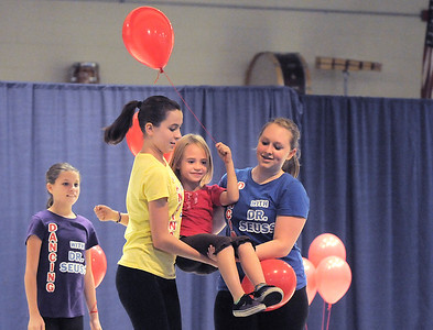 "Mara Poe, 8, center, is carried by Gabby Green, 15, left, and Alie Borman, 17, for the reading of the Dr. Seuss book ""Great Day For Up"" during  Wednesday's Children's Dance Theater's performance of Dancing With Dr. Seuss at Kohl Elementary School. September 14, 2011 staff photo/ David R. Jennings"