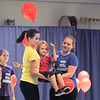 "Mara Poe, 8, center, is carried by Gabby Green, 15, left, and Alie Borman, 17, for the reading of the Dr. Seuss book ""Great Day For Up"" during  Wednesday's Children's Dance Theater's performance of Dancing With Dr. Seuss at Kohl Elementary School.<br /> September 14, 2011<br /> staff photo/ David R. Jennings"