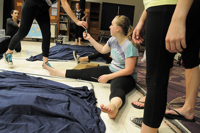 Allie Borman, 17, helps disassemble the set after Wednesday's Children's Dance Theater performance of Dancing With Dr. Seuss at Kohl Elementary School. Cast members not only dance but put up and take down the set. September 14, 2011 staff photo/ David R. Jennings