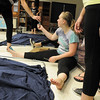 Allie Borman, 17, helps disassemble the set after Wednesday's Children's Dance Theater performance of Dancing With Dr. Seuss at Kohl Elementary School. Cast members not only dance but put up and take down the set.<br /> September 14, 2011<br /> staff photo/ David R. Jennings