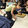 Celeste Williams, 12, , helps disassemble the set after Wednesday's Children's Dance Theater performance of Dancing With Dr. Seuss at Kohl Elementary School. Cast members not only dance but put up and take down the set.<br /> September 14, 2011<br /> staff photo/ David R. Jennings