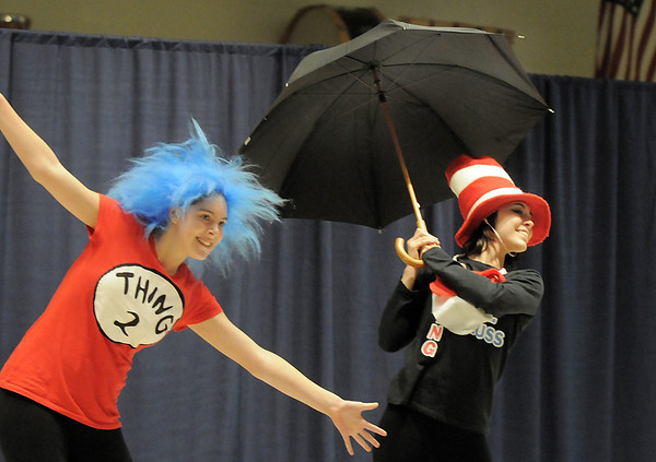 Tiana Threlkel, 17, right, as the Cat in the Hat, dances Elise Timme, 15, as Thing 2, during Wednesday's Children's Dance Theater's performance of Dancing With Dr. Seuss at Kohl Elementary School.<br /> September 14, 2011<br /> staff photo/ David R. Jennings