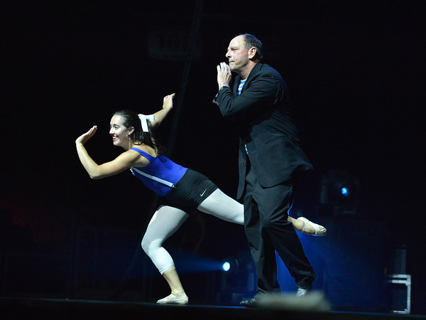 Tom Schiola dances the swing with Sophie Payannet with Danse Etoile Ballet during the 3rd Annual Dancing with the Broomfield Stars at the 1stBank Center on Thursday. Dancing with the Broomfield Stars is a fundraiser for the Broomfield Community Foundation.<br /> September 20, 2012<br /> staff photo/ David R. Jennings