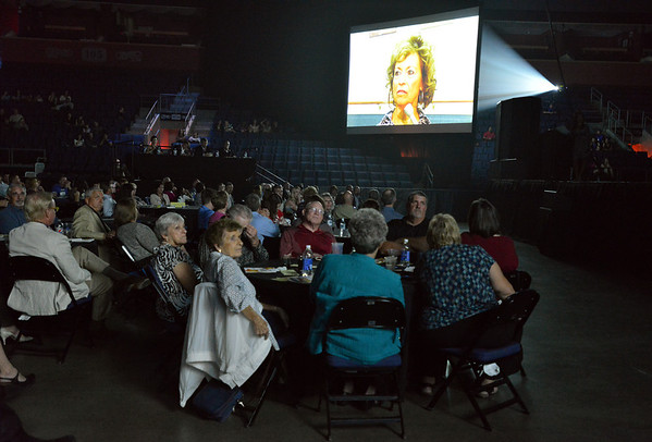 The audeince watches interview of the dancers on big screens before the dancers perform at the 3rd Annual Dancing with the Broomfield Stars at the 1stBank Center on Thursday. Dancing with the Broomfield Stars is a fundraiser for the Broomfield Community Foundation.<br /> September 20, 2012<br /> staff photo/ David R. Jennings