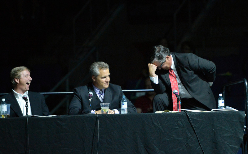 "Dancing judge  Dave Delozier , right, does a ""Tebow"" at  the 3rd Annual Dancing with the Broomfield Stars at the 1stBank Center on Thursday. Dancing with the Broomfield Stars is a fundraiser for the Broomfield Community Foundation.<br /> September 20, 2012<br /> staff photo/ David R. Jennings"