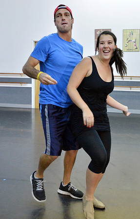 Dancing with the Broomfield Stars star, Brandon Smith dances with Taps N Toes instructor Carlee Taga during a rehearsal at Dance Arts Studio.<br />  August 17, 2012<br /> staff photo/ David R. Jennings