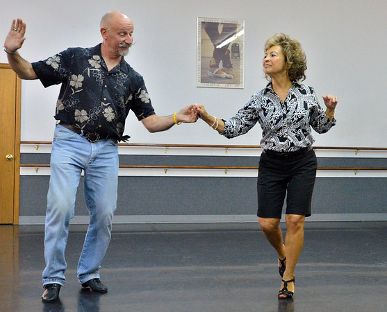 Dancing with the Broomfield Stars star, Ladonna Scheel,  dances withReverence Academy of Dance instructor Gerry Stephenson during a rehearsal at Dance Arts Studio.<br />  August 17, 2012<br /> staff photo/ David R. Jennings