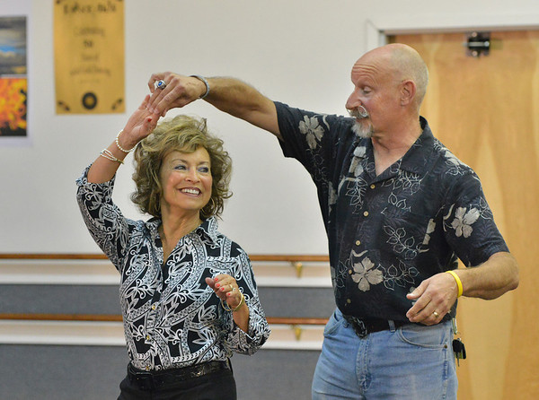 Dancing with the Broomfield Stars star, Ladonna Scheel, left, dances with Reverence Academy of Dance instructor Gerry Stephenson during a rehearsal at Dance Arts Studio.<br />  August 17, 2012<br /> staff photo/ David R. Jennings