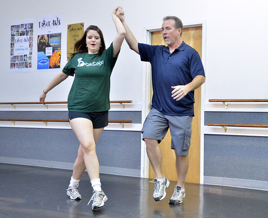 Dancing with the Broomfield Stars star, Phil Kennedy,  dances with Heritage Irish Stepdancers instructor Kelseigh Fulton during a rehearsal at Dance Arts Studio.<br />  August 17, 2012<br /> staff photo/ David R. Jennings