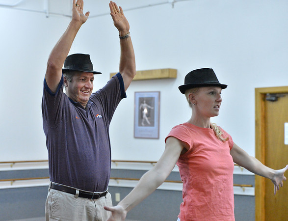 Dancing with the Broomfield Stars star, Mike Croell dances with Dance Arts Studio instructor Stephanie McGill during a rehearsal at Dance Arts Studio.<br />  August 17, 2012<br /> staff photo/ David R. Jennings