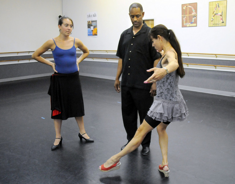 Marie-Jose Payannet, right, helps Ken Brown and Sophie Payannet rehearse their routine for Dancing with the Broomfield Stars.<br /> <br /> September, 2010<br /> staff photo/David R. Jennings